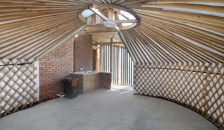 Liberated interior space and thermal mass brick wall Rural Urban Framework (RUF)