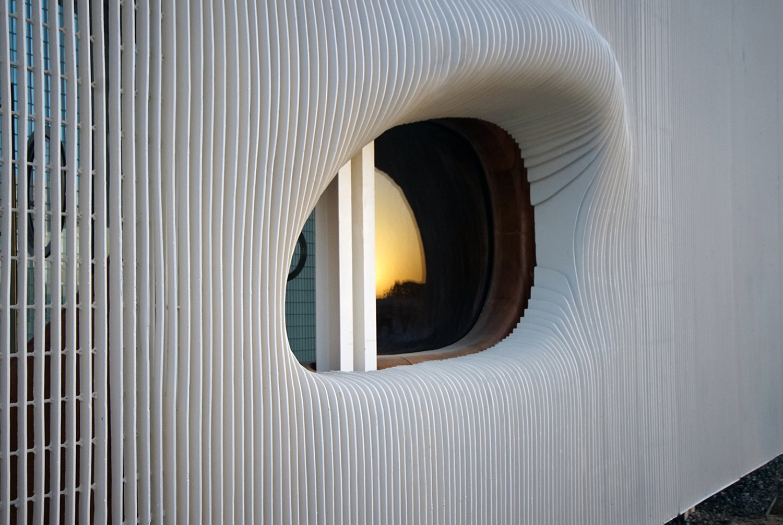 Detail view of Oculus window at sunset Juan Roldan, 2018