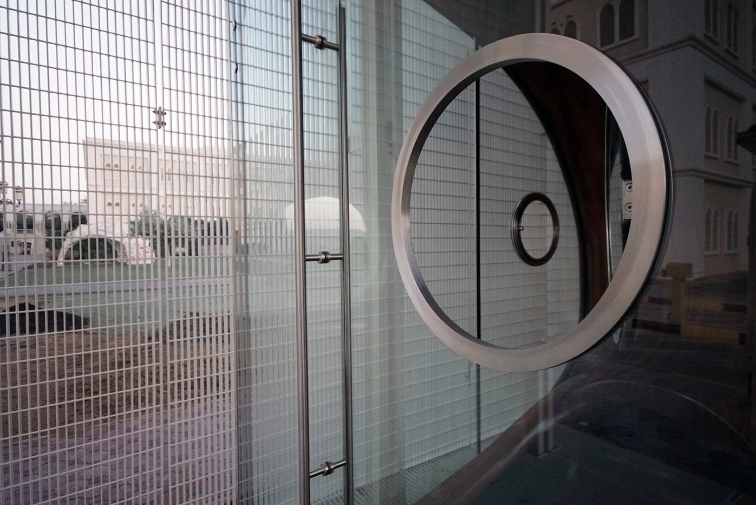 View of Security Booth air conditioned space through entry door and porthole window Juan Roldan, 2018