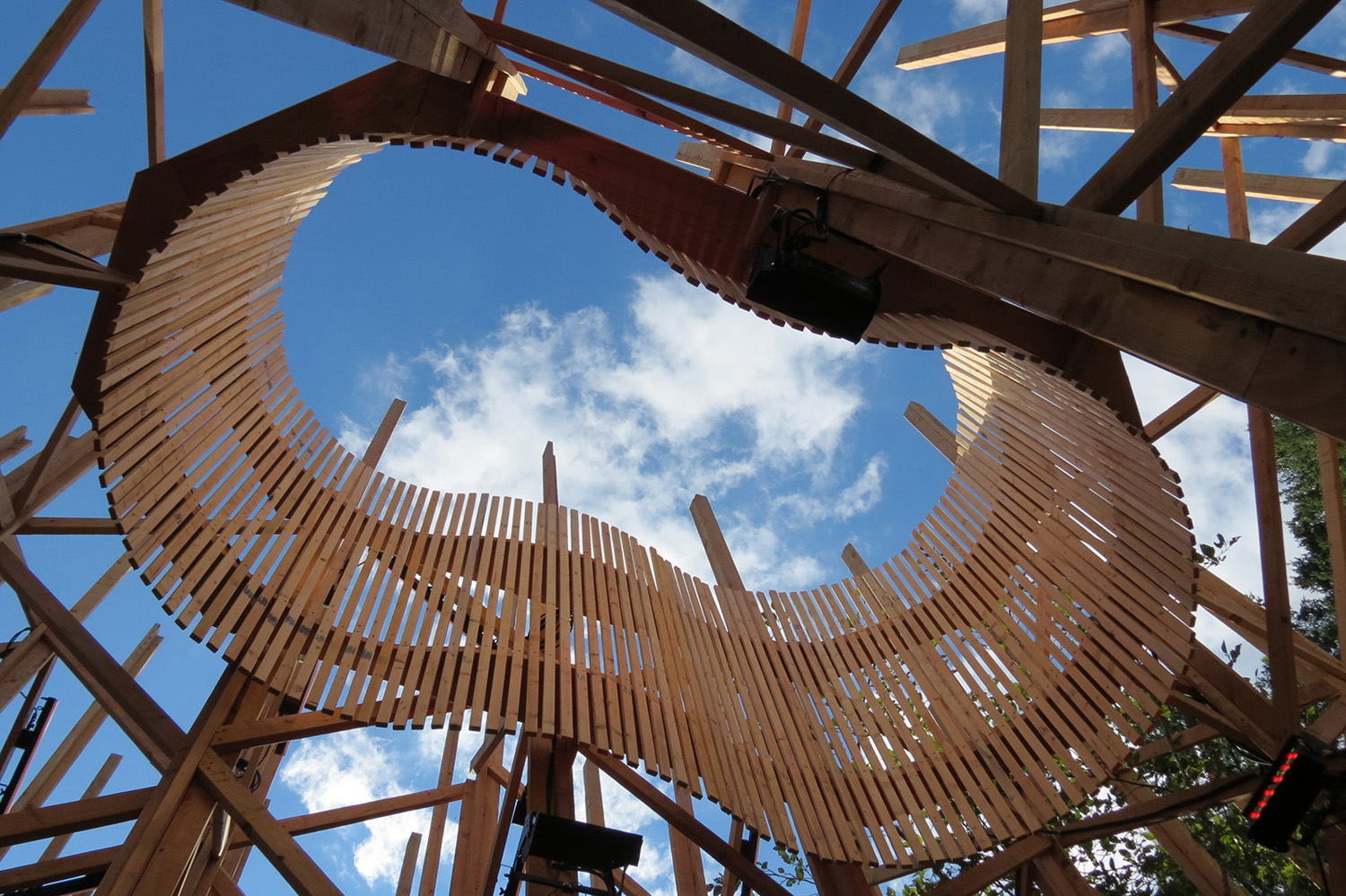 Above the benches the 'nesculus' (nest + oculus) frames the sky Clive Knights