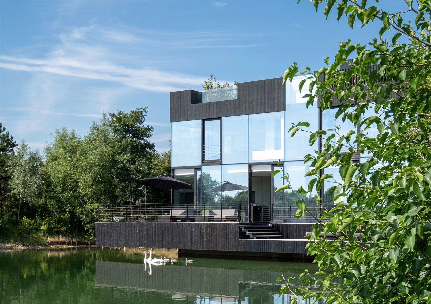 View from the lake - house in located in the lakes by Yoo. Blue Sky Images