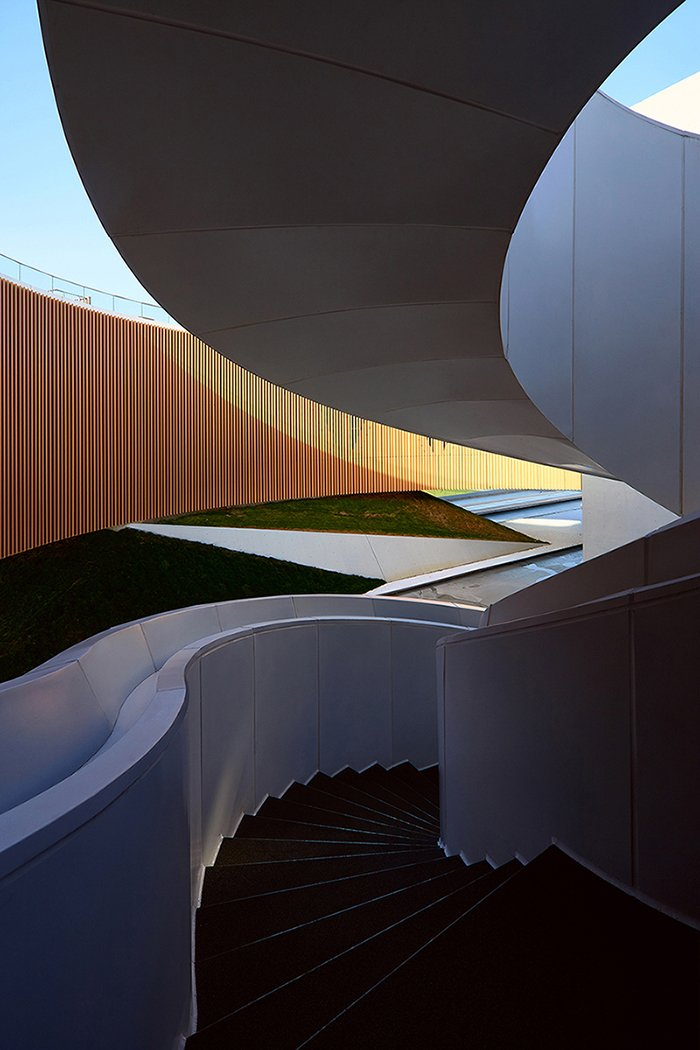 Looking out from the spiral stairs on the rooftop courtyard Su Chen