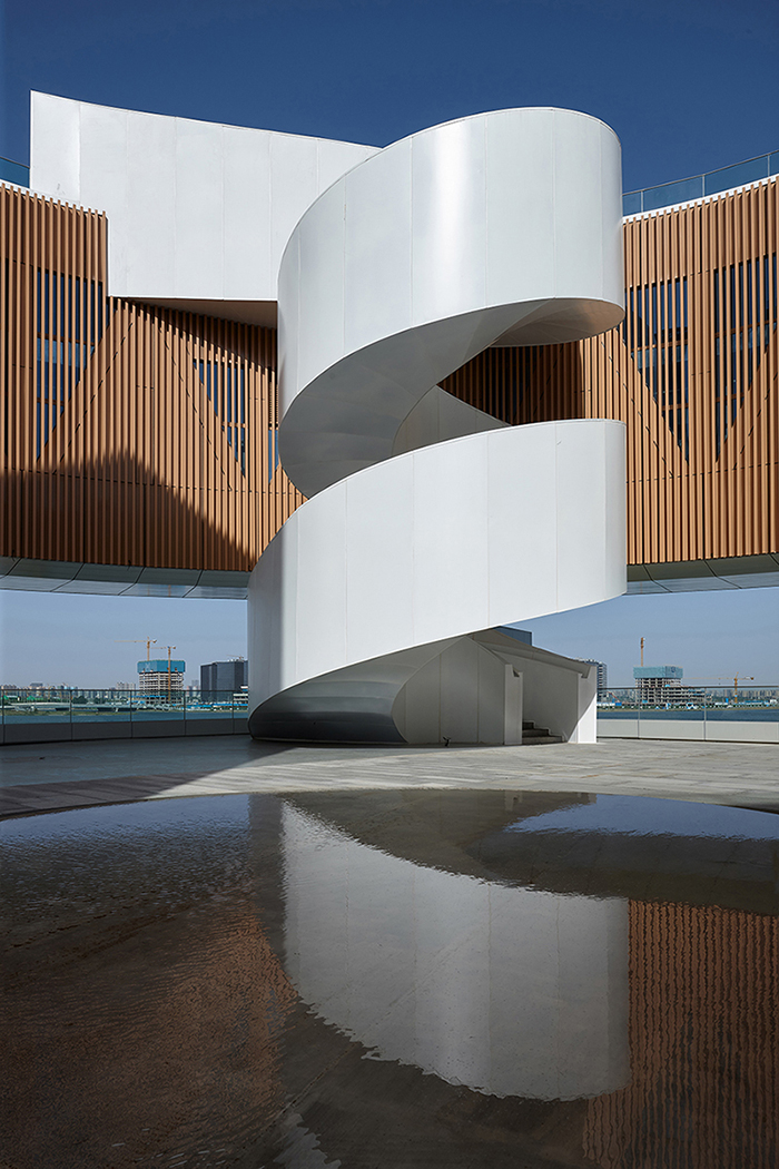 The 'Elephant' spiral stairs in the courtyard on the rooftop Su Chen