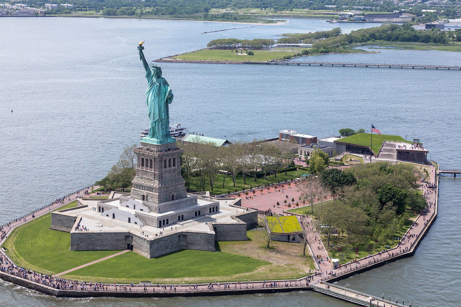 The museum and the Statue of Liberty—located on opposite ends of Liberty Island. Copyright Iwan Baan