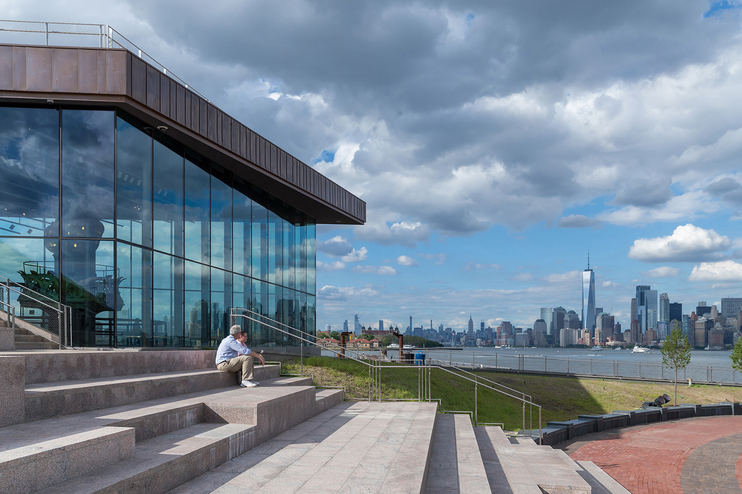 Granite steps provide space for sitting and resting, with a view toward Manhattan. Copyright Iwan Baan