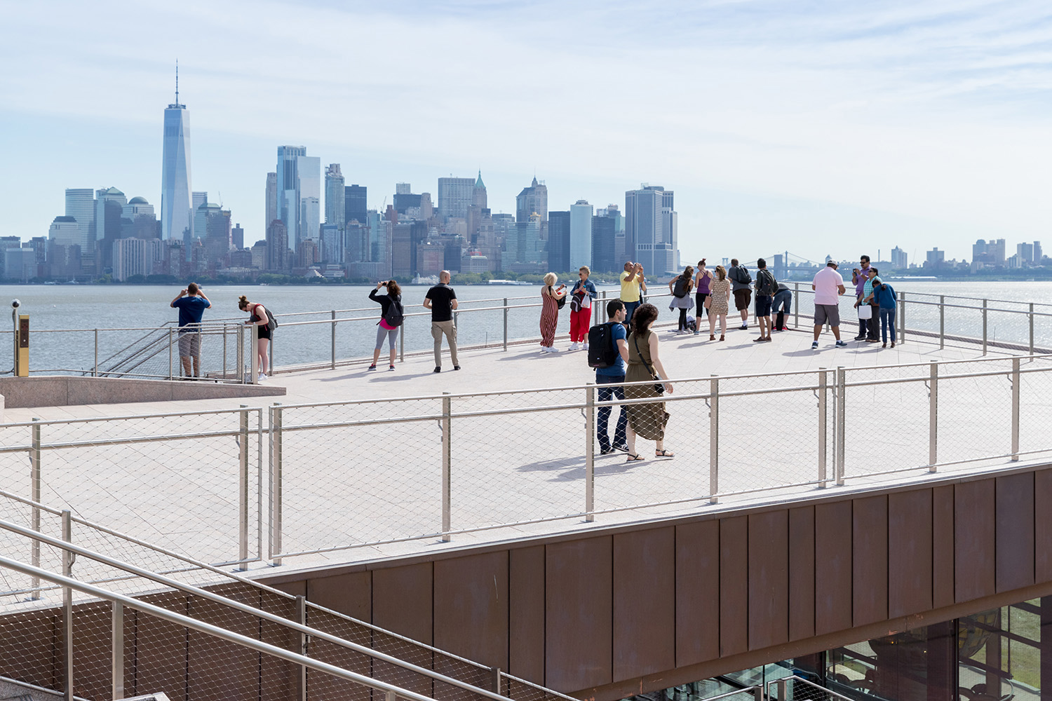 Unobstructed views of the Manhattan skyline and New York Harbor from the granite roof terrace. Copyright Iwan Baan
