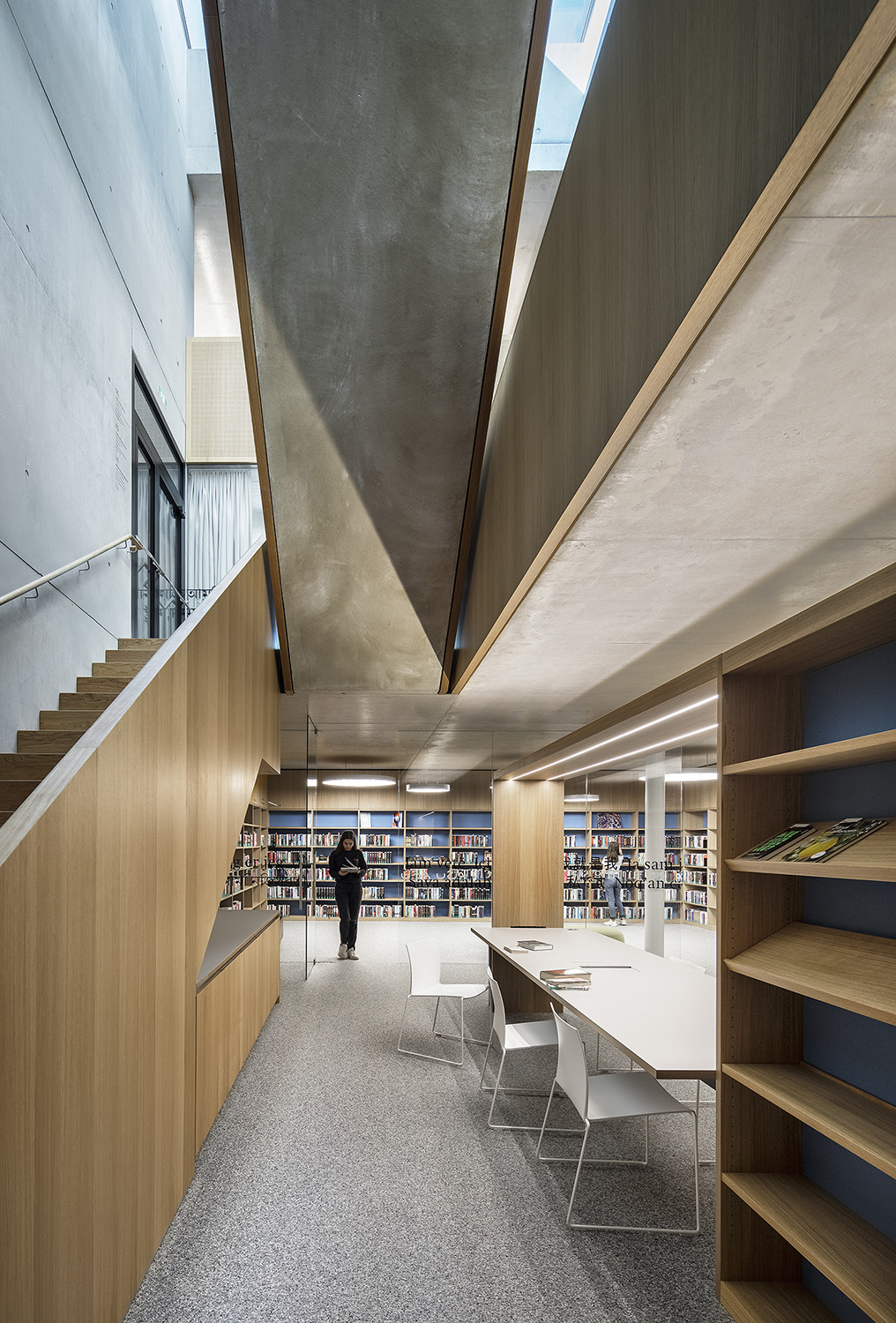 A single-flight staircase leads to the basement with the media library, the games library and an open maker's space. Albrecht I. Schnabel