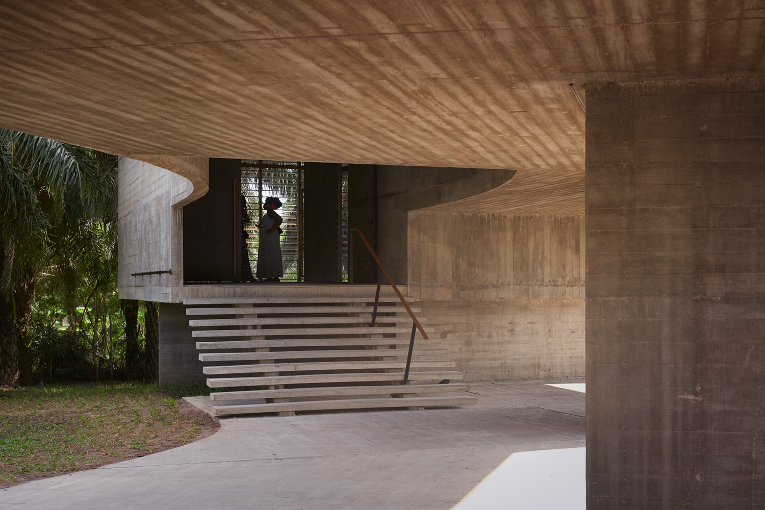 The new gallery is accessed from below via steps leading into a split-level exhibition space Julien Lanoo