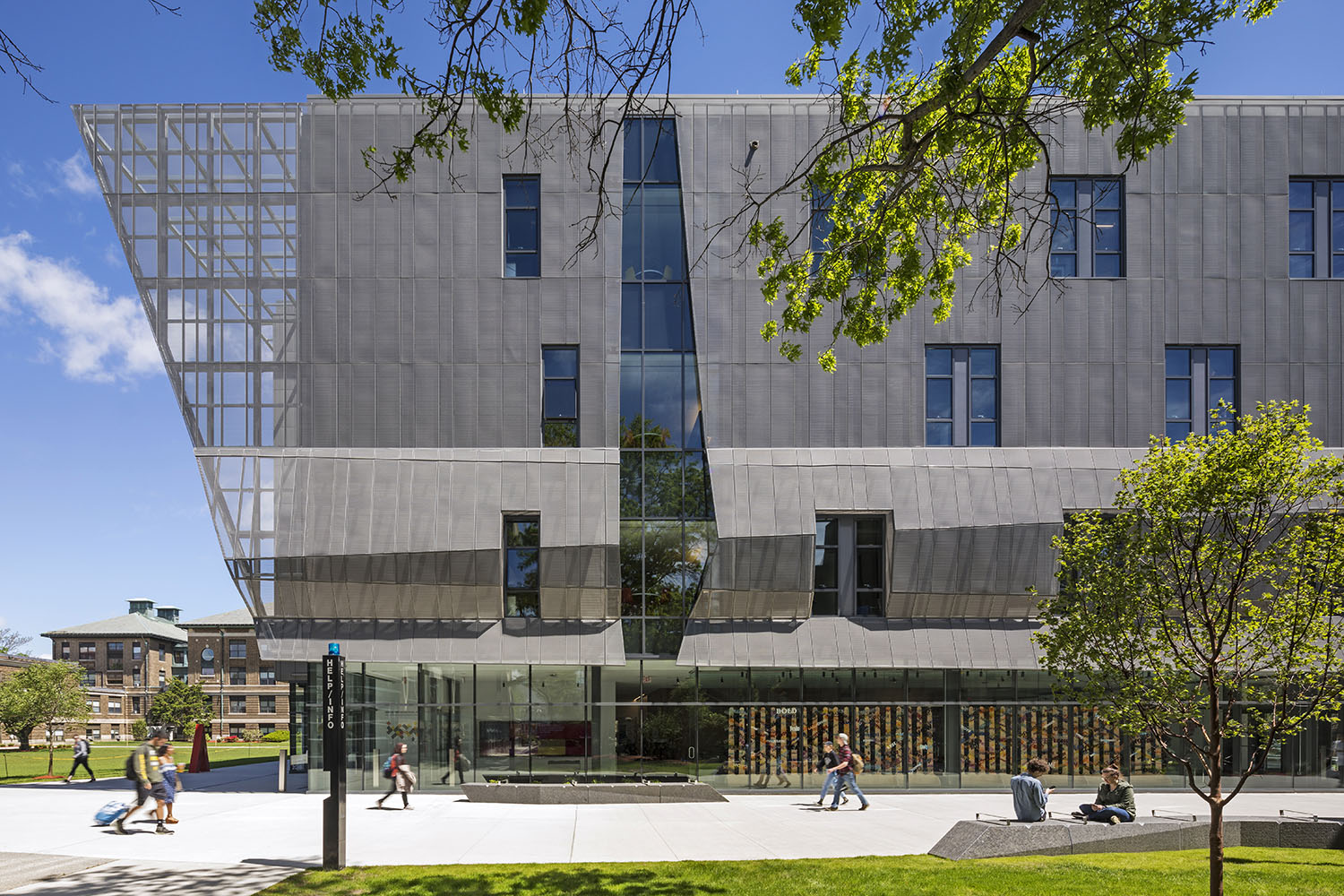 """A Perforated """"Veil"""" Gives the Compact Building a Distinct Identity Albert Vecerka"""