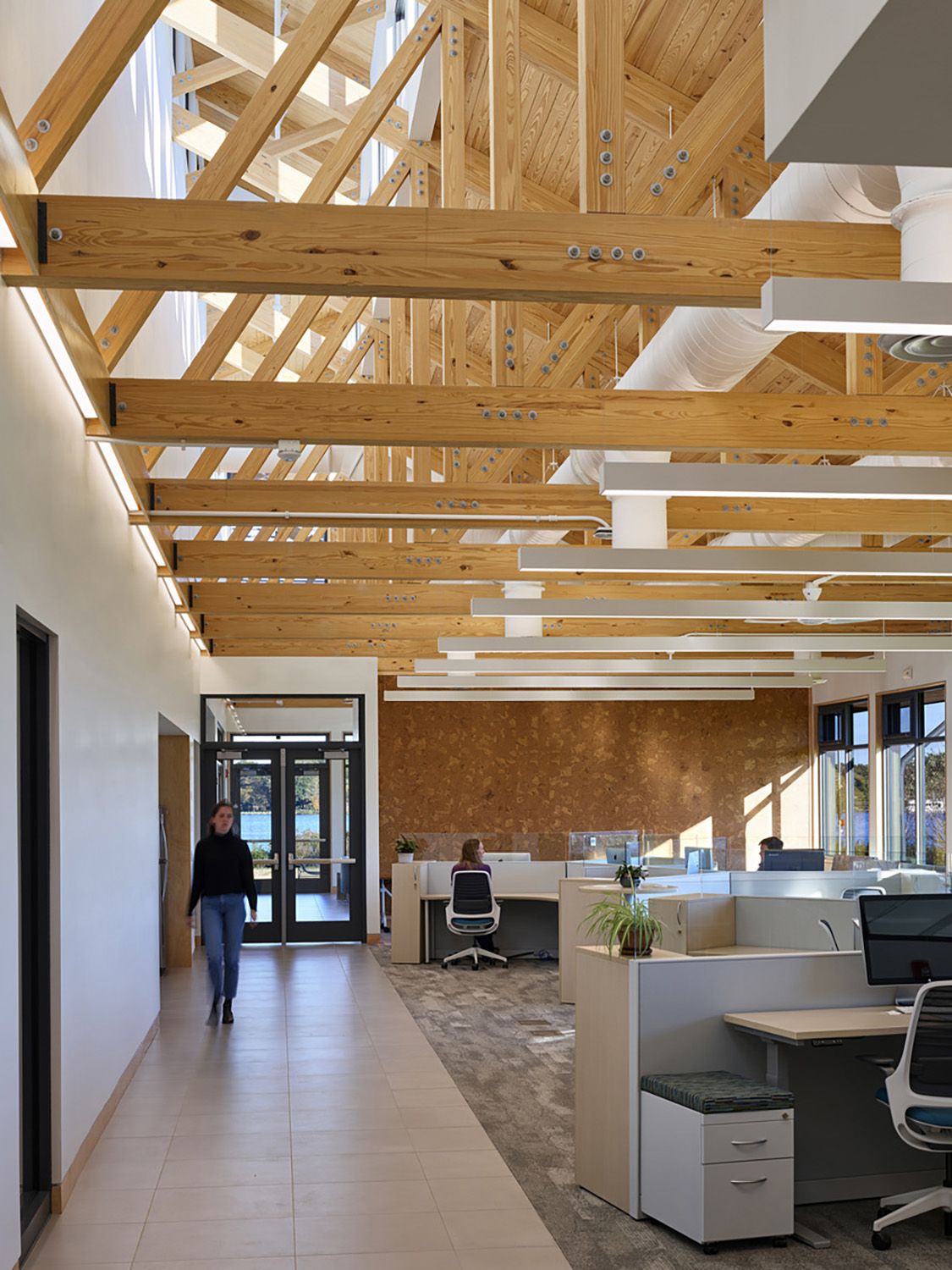 Biophilic materials and river vistas enrich the interior experience ©Tom Holdsworth