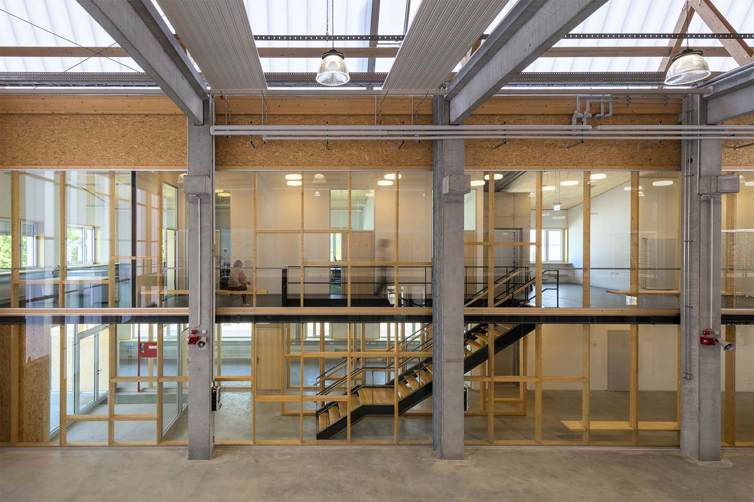 In the building centre, a stairway and elevator lead to the upper storey. David Matthiessen