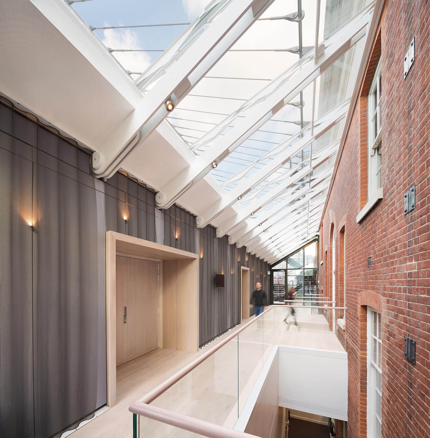 Glazed lobby to Recital Hall enhances the Academy's circulation routes, creating a link between the old and new buildings Adam Scott
