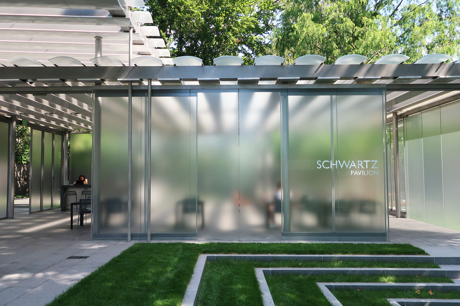 Light responsive materials of the canopy and vertical partitions provide privacy, delineate space, and display activity and occupancy Richard Kress, courtesy of James Carpenter Design Associates