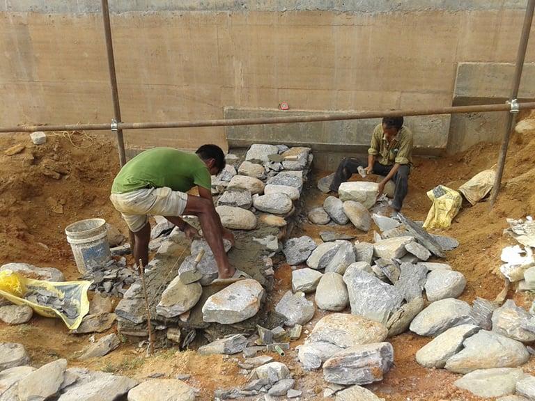 Construction of retaining walls with local mortared stone Sharon Davis Design}