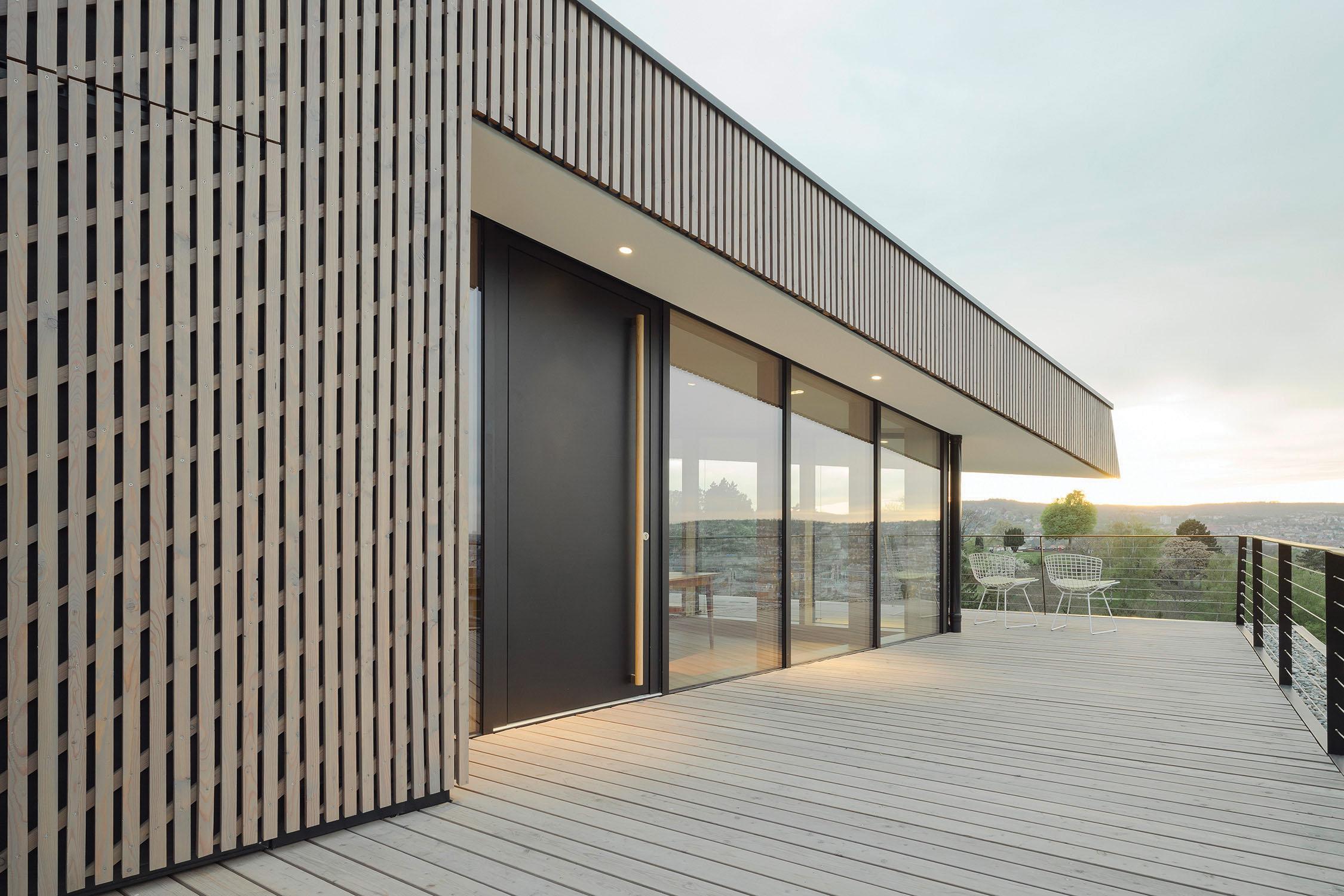 Northeast rooftop terrace with larch wood lath facade Brigida González