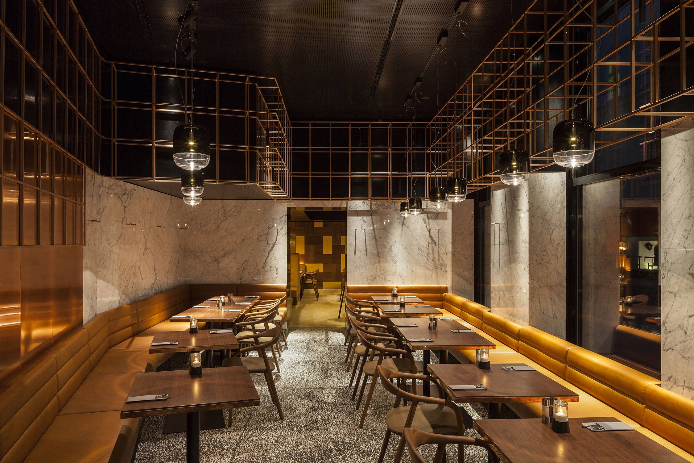 Clad in marble, it makes reference to the timeless culture of an Italian tavern Copyrights: Rupert Steiner