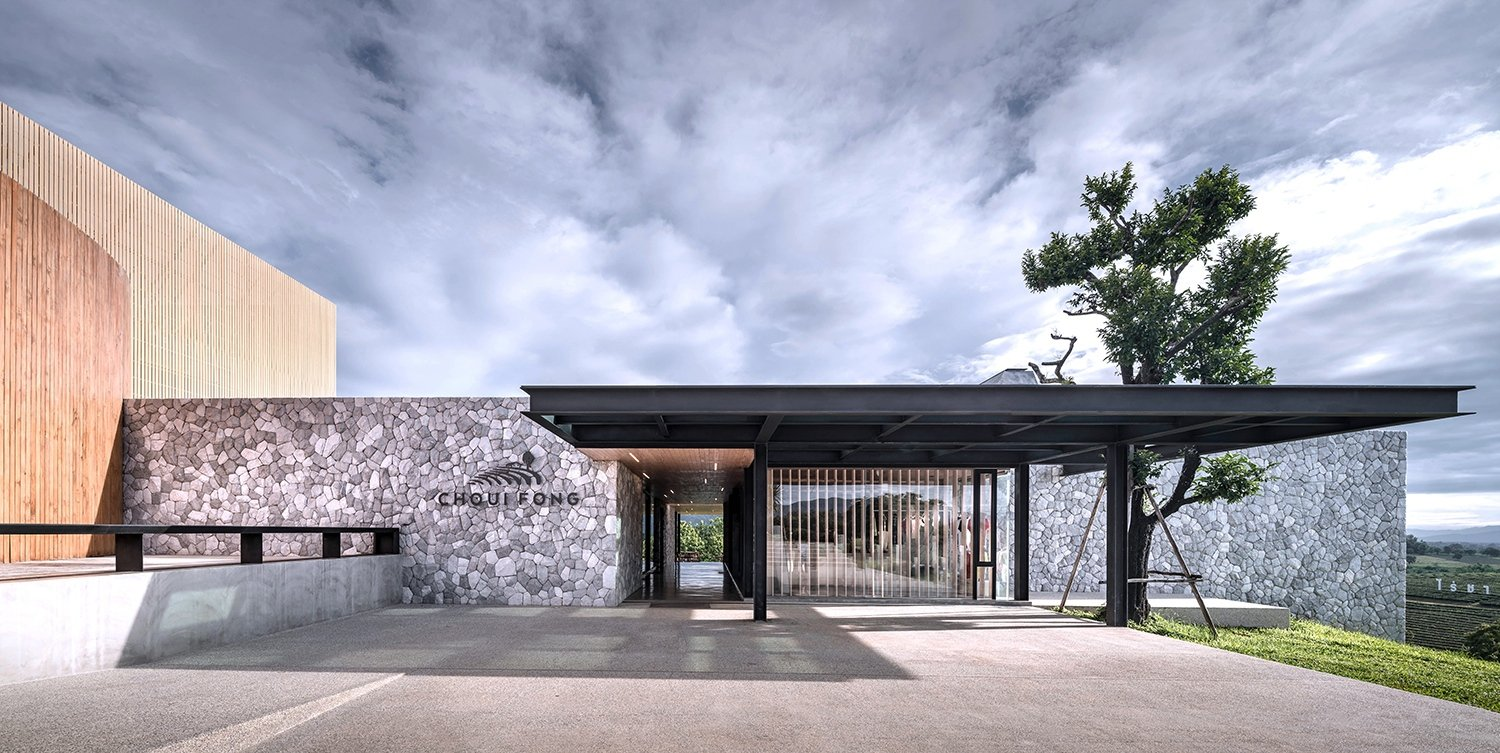 Main entrance which its wall is made of mountain stone. Depth of Field Co., Ltd