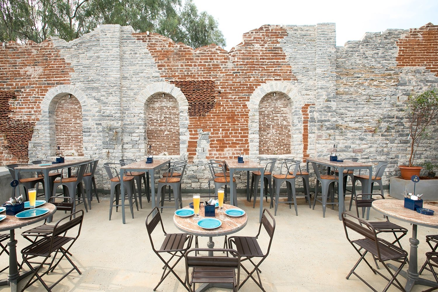 Wall composed of rugged mix of stone arches, tiles and brick set in lime mortar Clare Arni