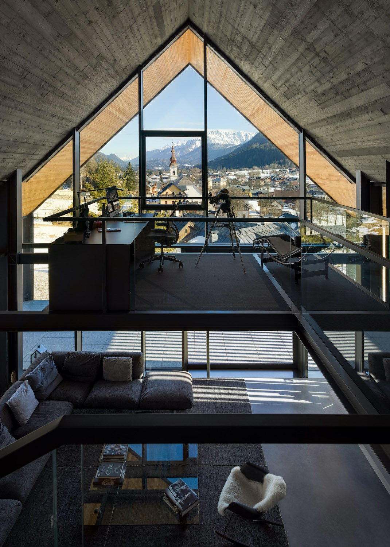 the master bedroom area is one the upper floor, overlooking the double height Gianni Antoniali