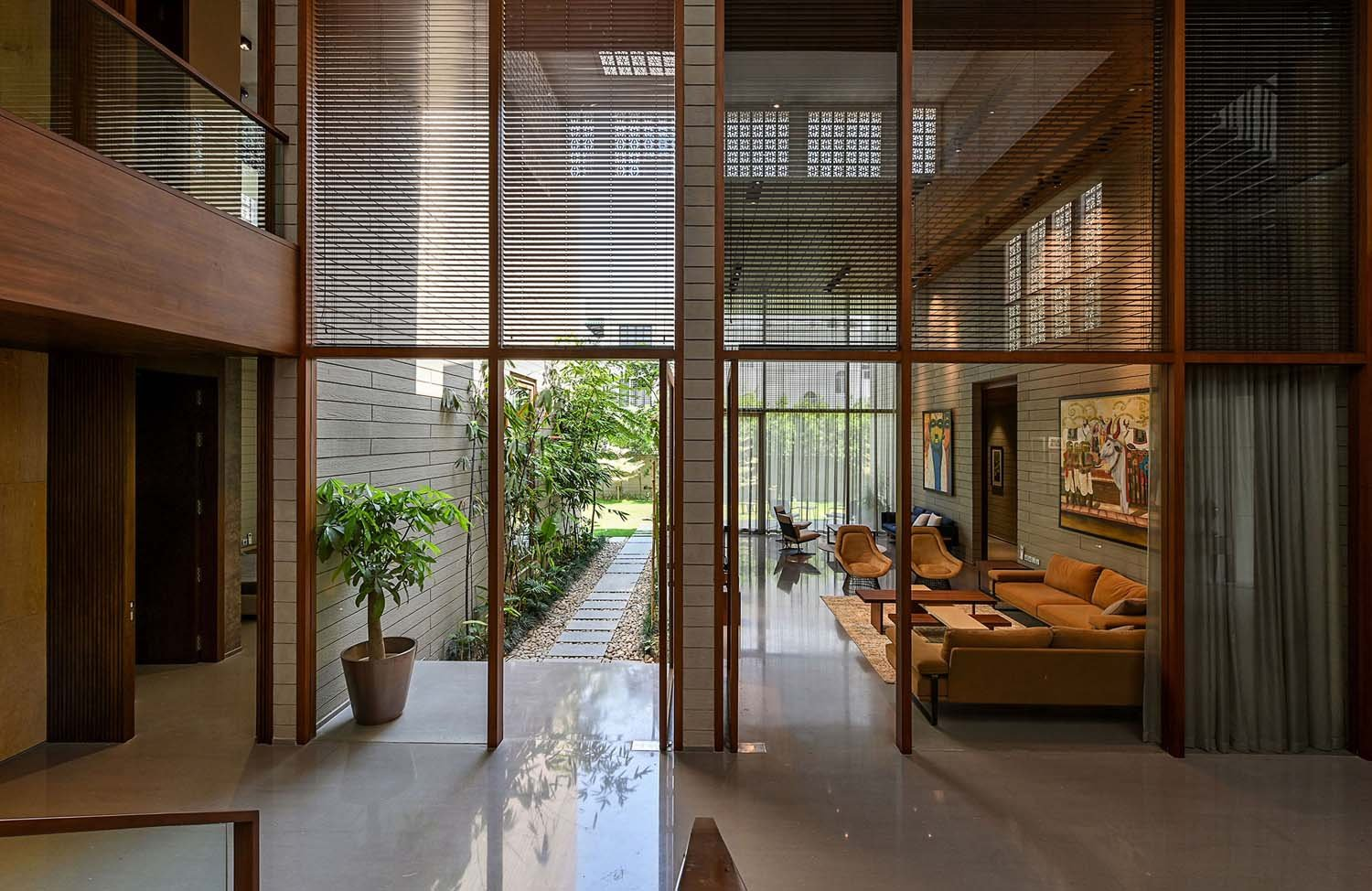 VIEW OF THE LIVING ROOM FROM THE COURTYARD DINESH MEHTA
