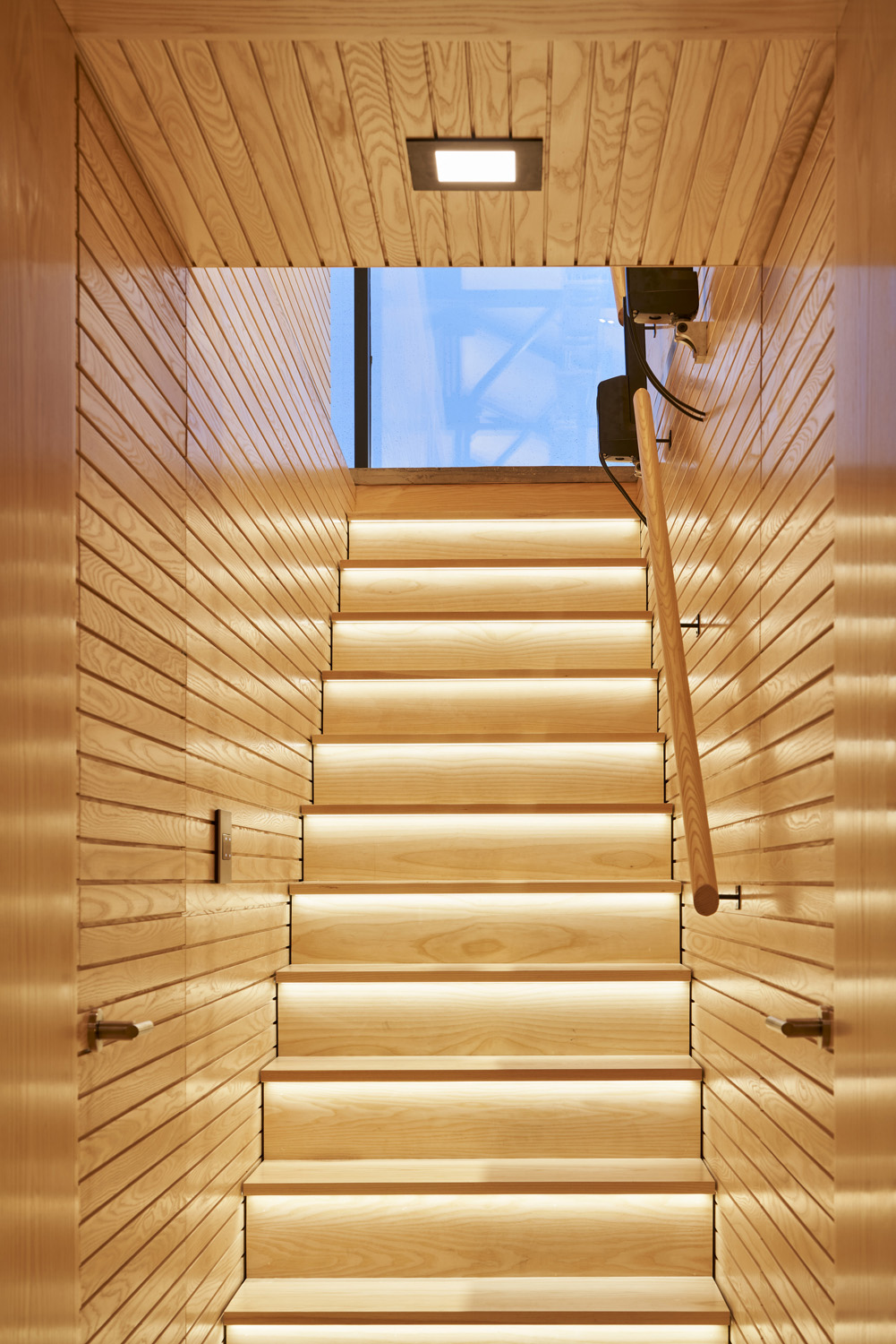 Secret white ash trap door and staircase Doublespace Photography Inc