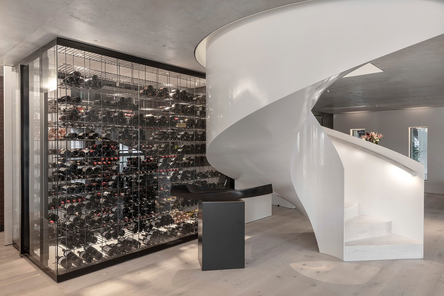 """Transparent glass wine room to help bring """"lightness"""" within the space. Delphine Burtin"""