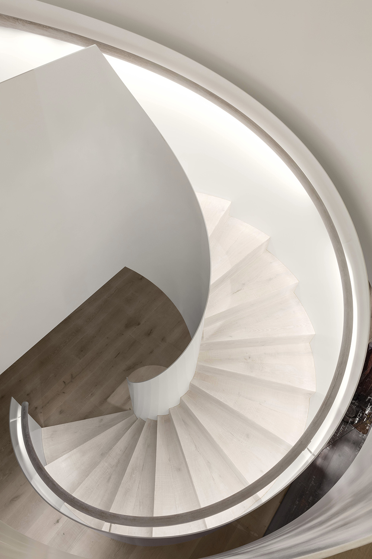 The circular staircase reflects the original circular window from the southern façade. Delphine Burtin