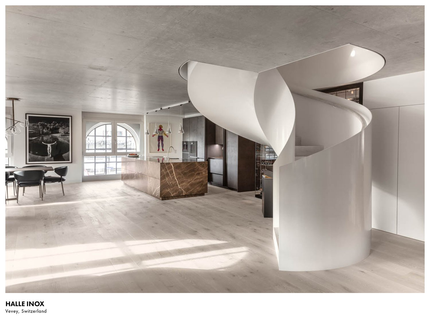 Located in the heart of Vevey, the 3-floor residence is set within the shell of an old tractor factory. Delphine Burtin}