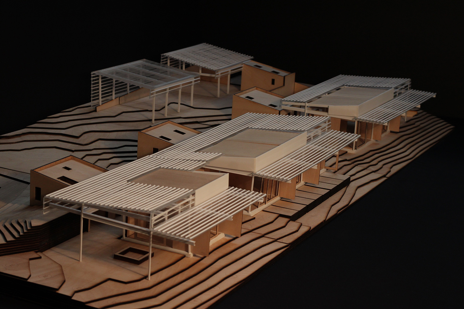 Design process model in wood and cardboard, view from southwest. Anderson Anderson Architecture}