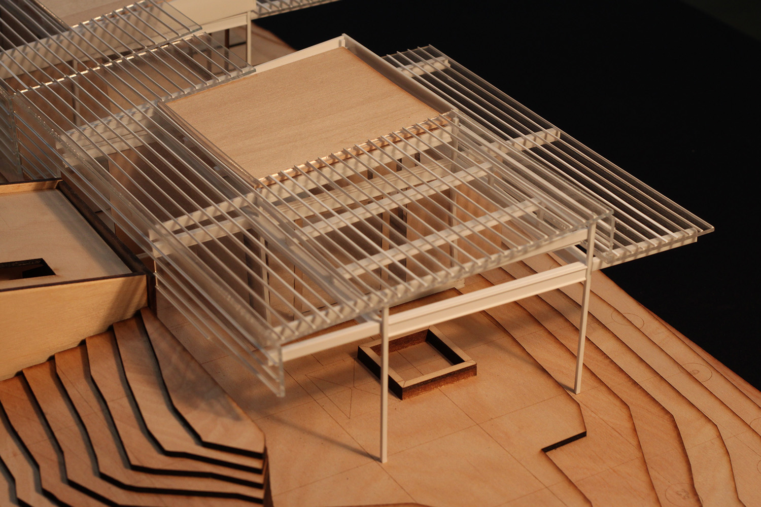 Design process model in wood and cardboard, view from northwest showing detail of umbrella roof structure. Anderson Anderson Architecture}