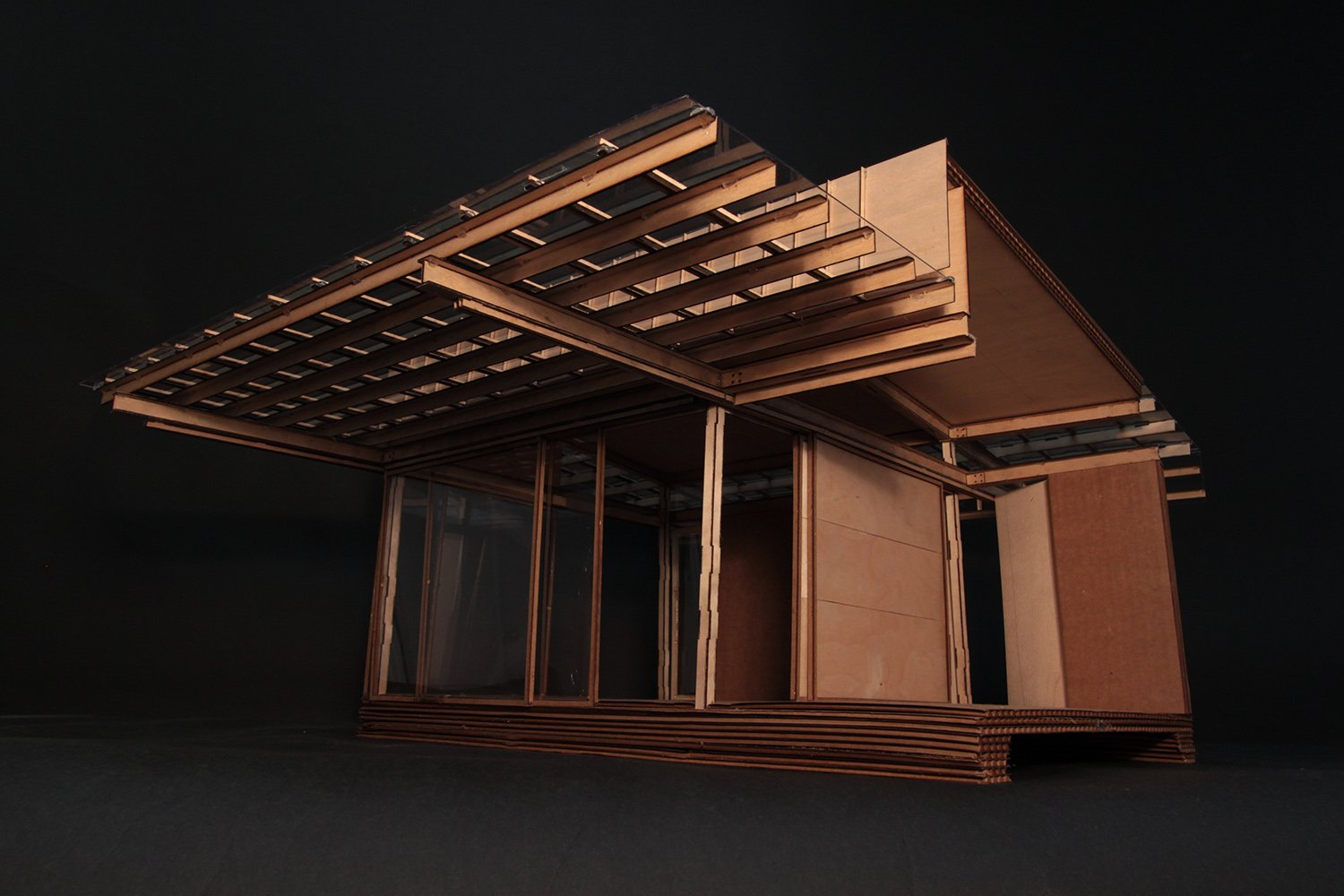Design process model in wood and cardboard, detail of south side sun shade and solar panel structure. Anderson Anderson Architecture}