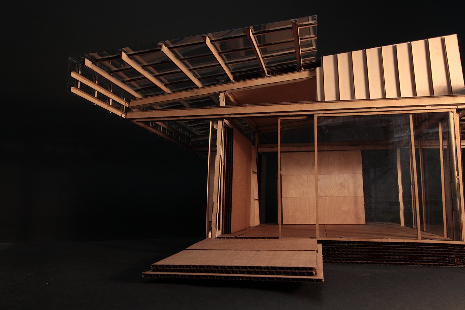 Design process model in wood and cardboard, detail of umbrella roof structure. Anderson Anderson Architecture}