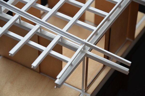 Design process model in wood and 3d printed ABS plastic, showing detail of prefabricated structural steel roof system. Anderson Anderson Architecture}