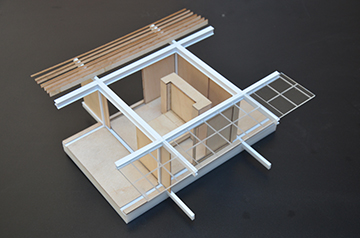 Design process model in wood and 3d printed ABS plastic, showing detail of primary structural steel beams and sliding wall/window panel tracks. Anderson Anderson Architecture}