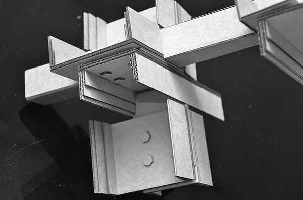1:1 scale design process model in cardboard showing typical structural steel connection of repeating module. Anderson Anderson Architecture}