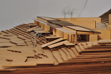 Early design process model in laser cut wood and cardboard to study integration of structure into the sloping site. Anderson Anderson Architecture}