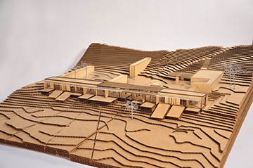 Early design process model in laser cut wood and cardboard. Aerial view from southeast to show entry courtyard area. Anderson Anderson Architecture}