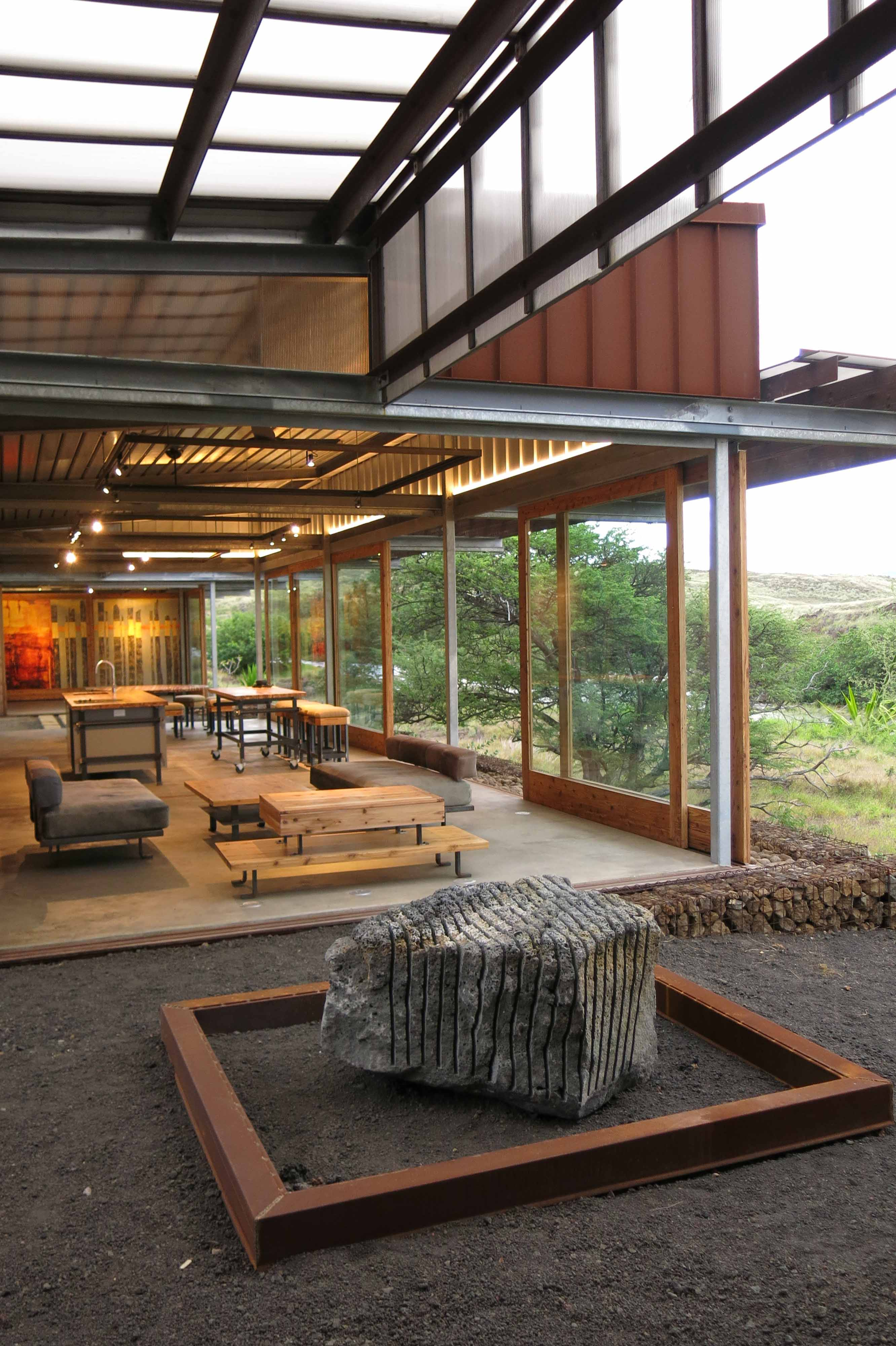 With sliding wall/window panels open, the indoor spaces can be opened to the surrounding landscape. John Russell