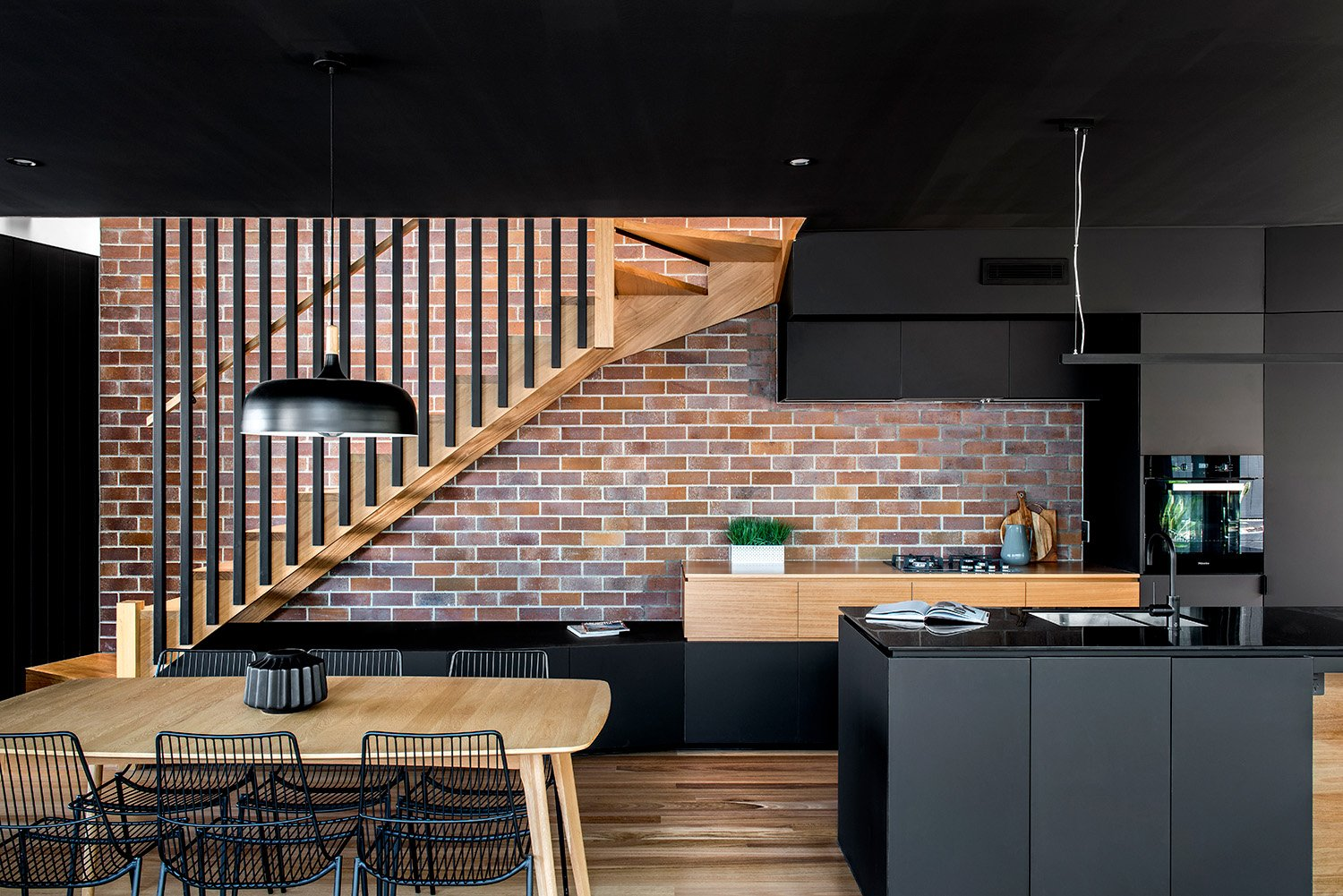 Brick, timber and dark kitchen cabinetry Cathy Schusler