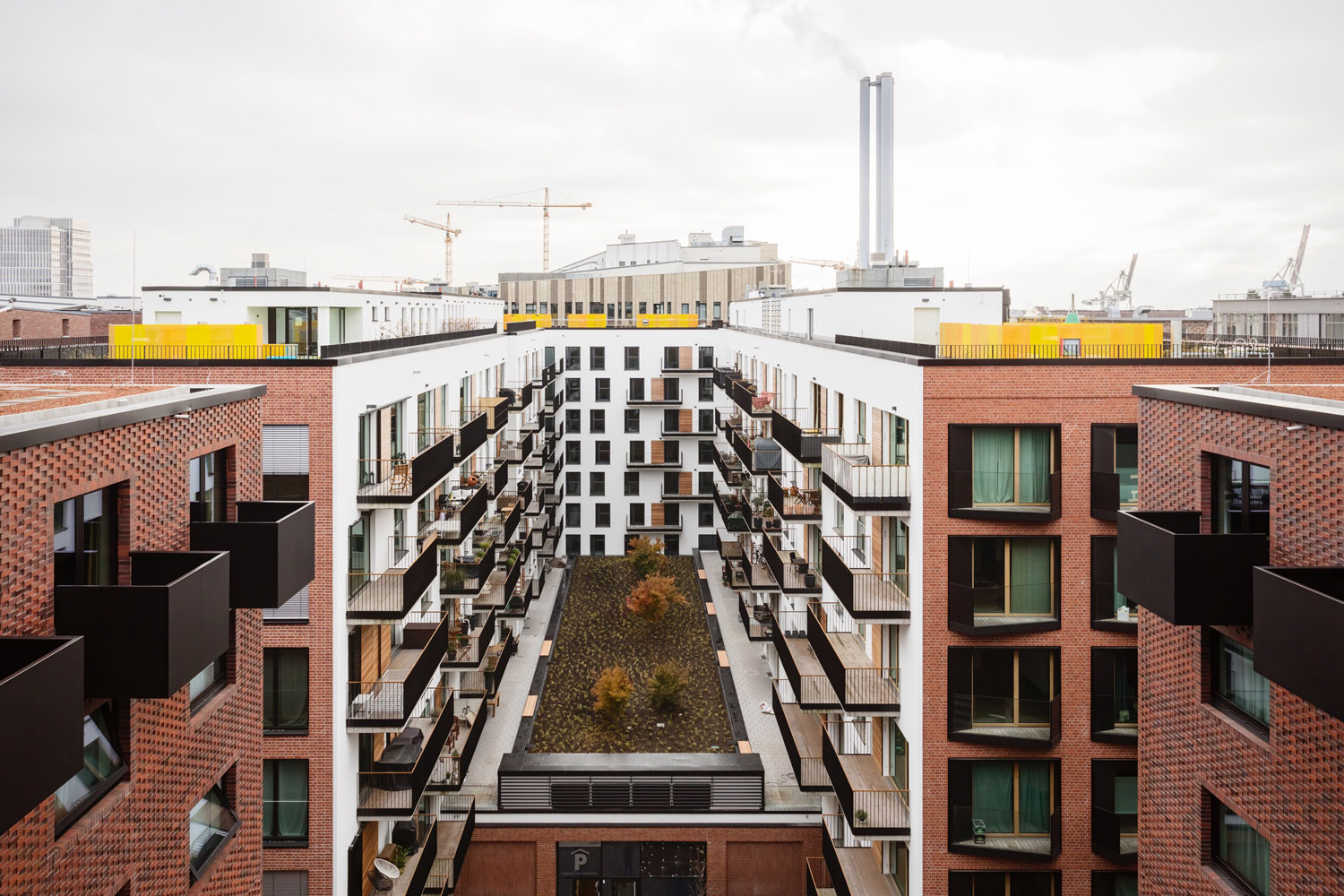 The inner courtyard and roof gardens are extensively planted with trees Marcus Bredt