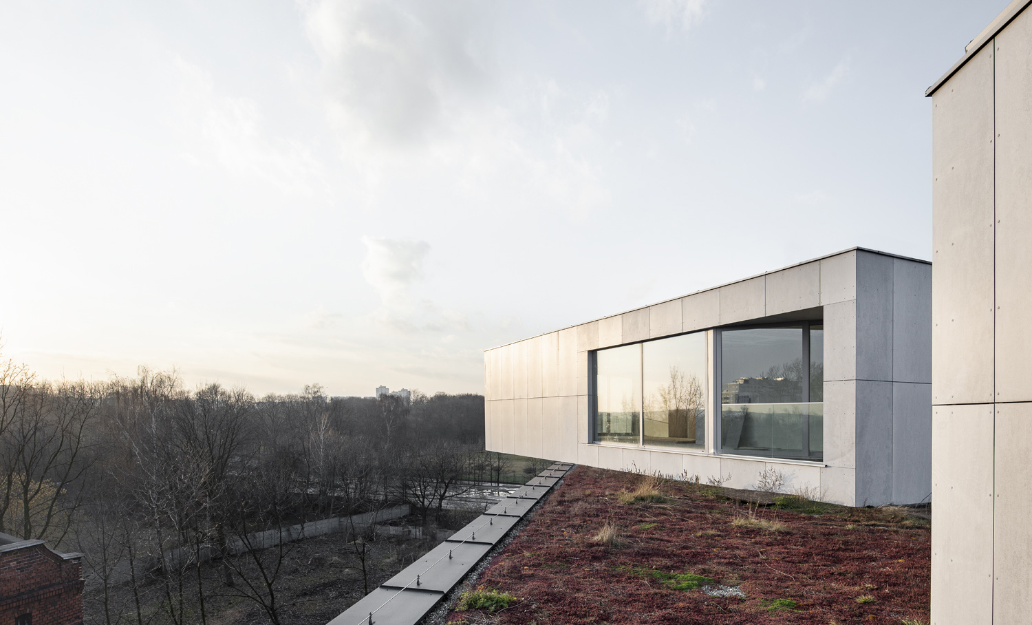 """All the inhabitants have a view to the nearby park, starting form """"houses with gardens"""" to end with villas on the roof Juliusz Sokolowski"""