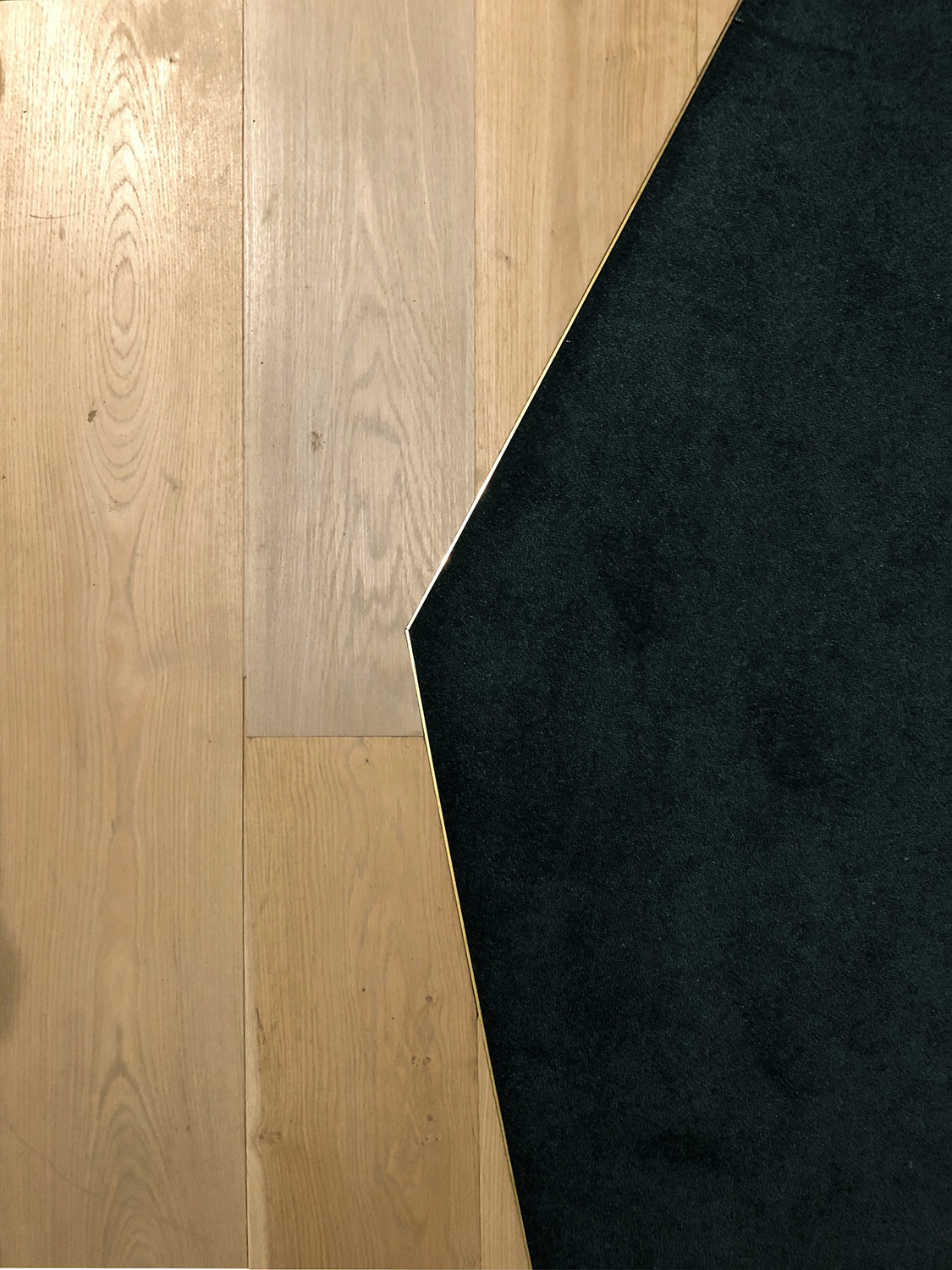 Detail: timber floor and green carpet Forte Architetti