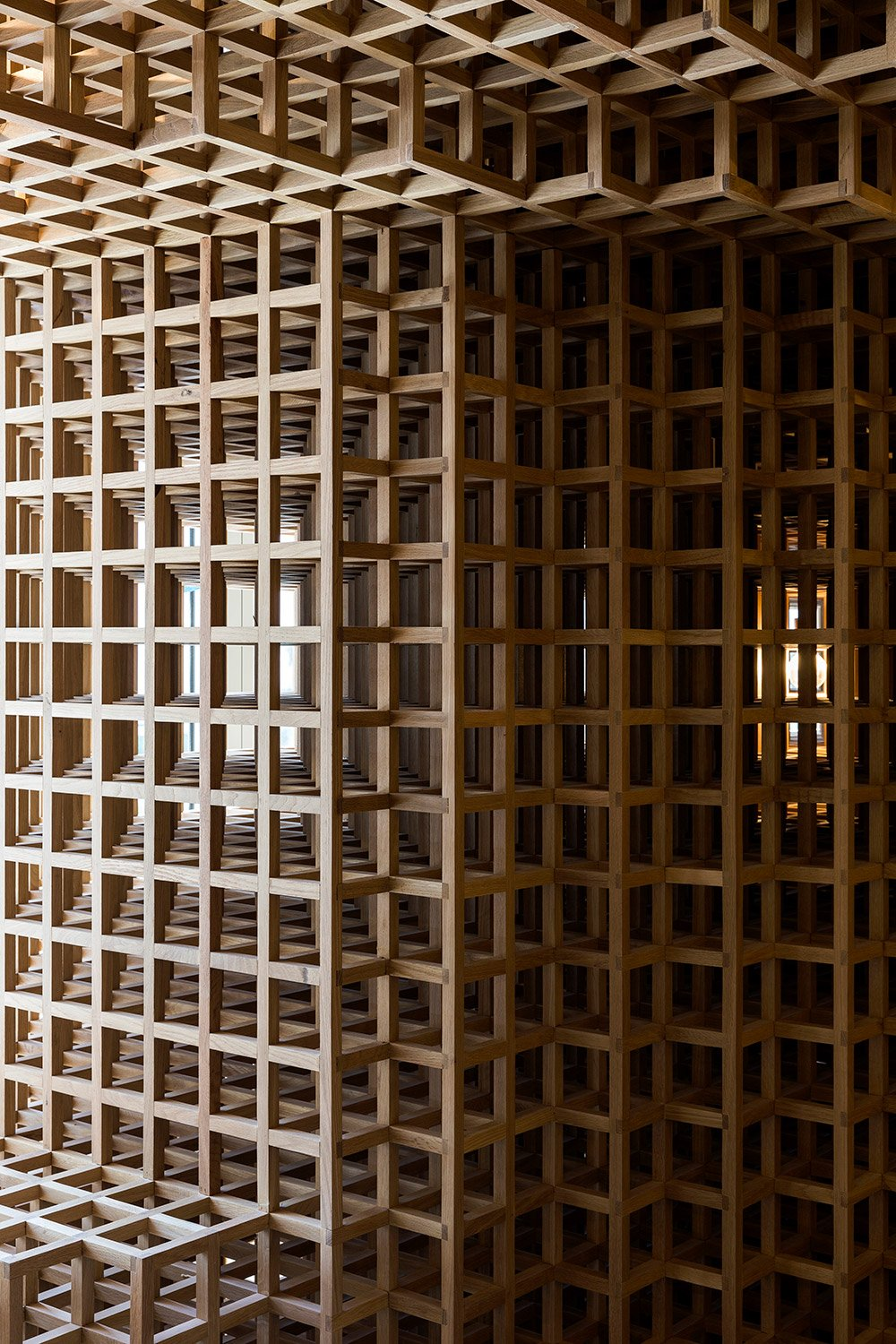 The cubes completely define the space, arranged in a curvature that almost defies their geometry. Filippo Bamberghi