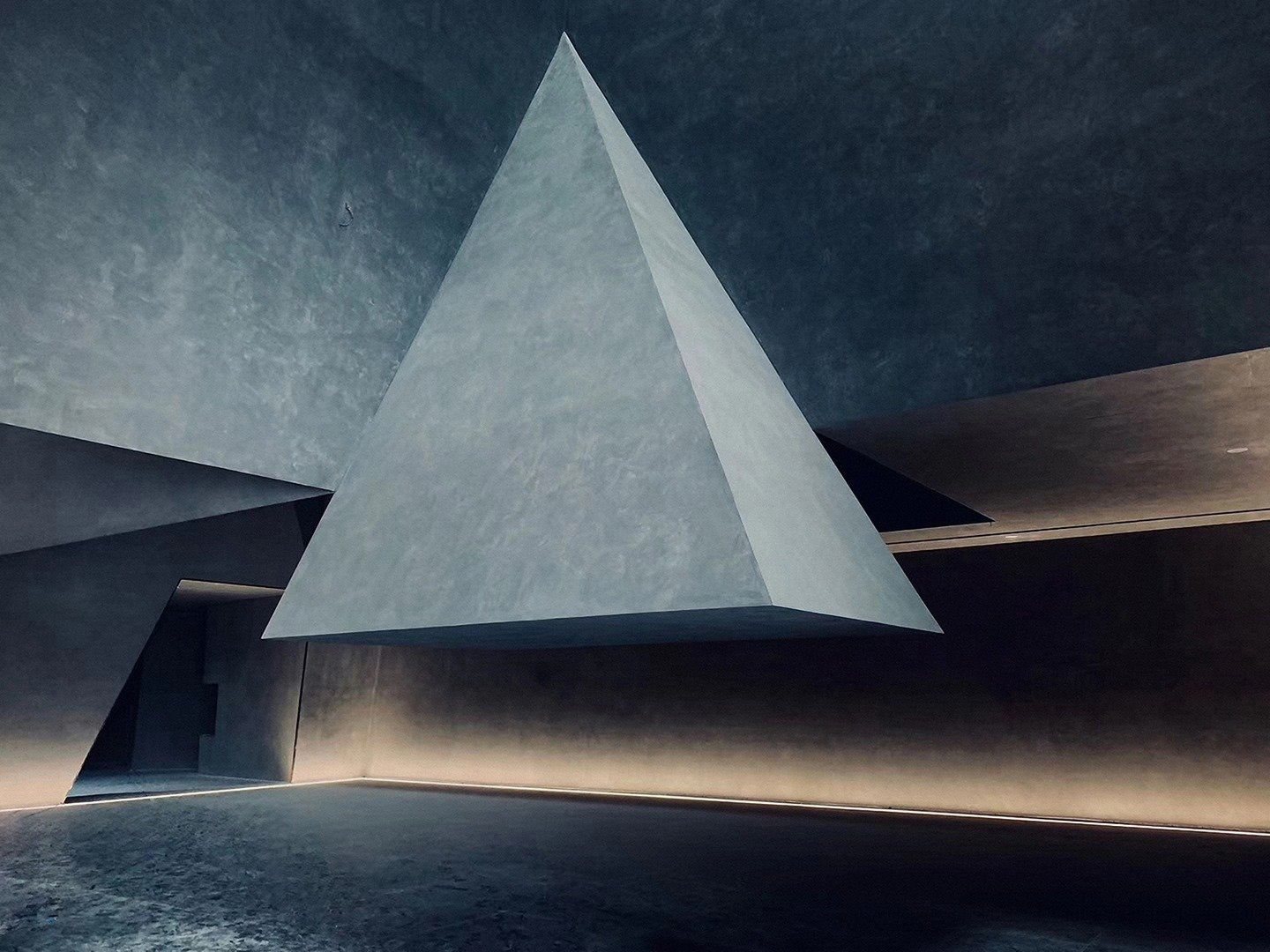 Atrium with rock above head Atelier Alter Architects
