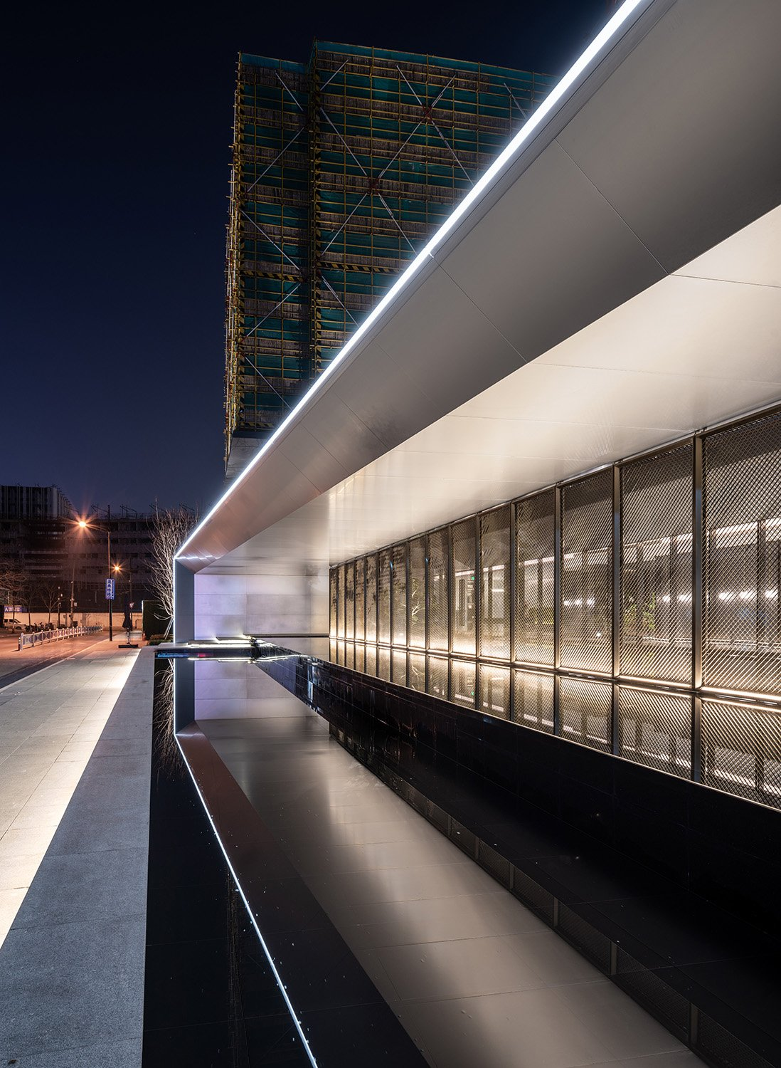 Over-scale cantilevered awning and water features Xi Chen