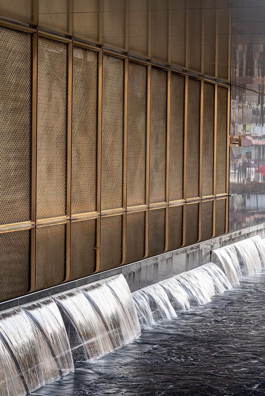 metal door leaf and water feature Xi Chen
