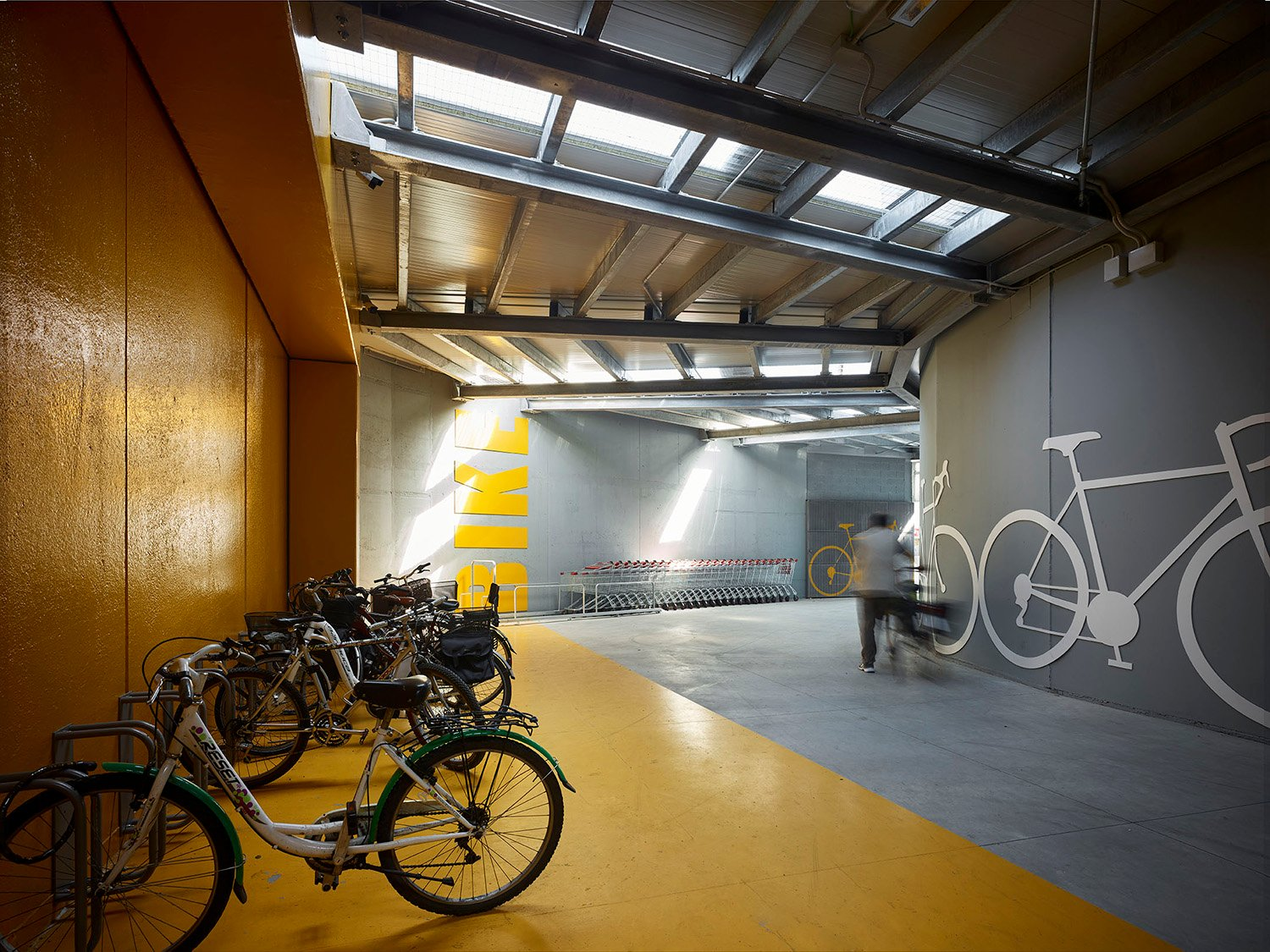 The covered space for parking and recharging bicycles Pietro Savorelli