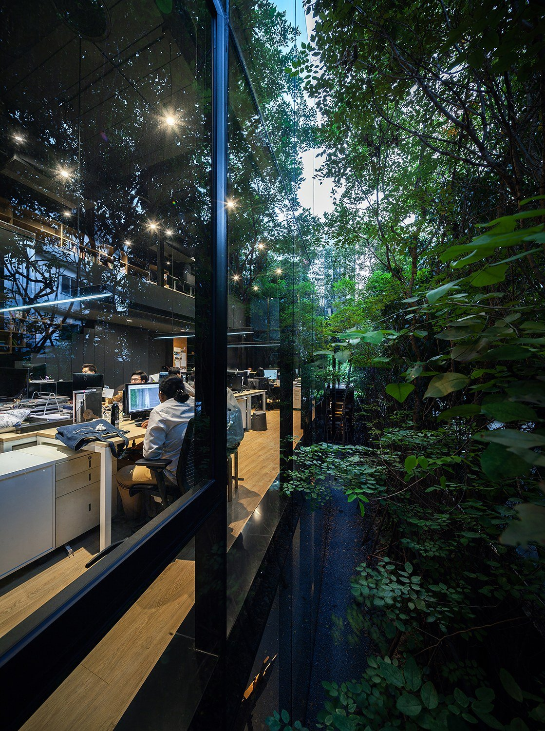 Working space on thee upstairs is kept private and surrounded by evergreen trees. Spaceshift