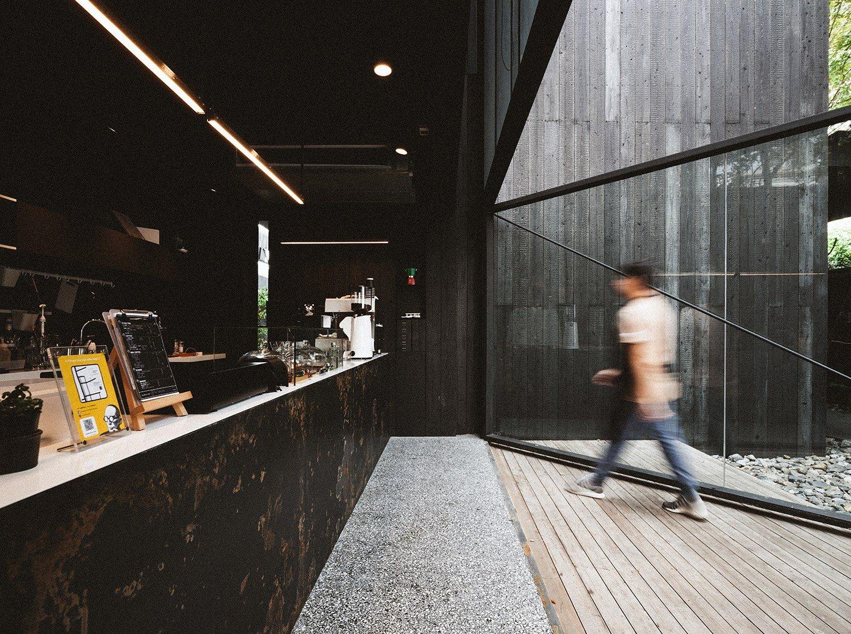 Wide-open window connects indoor and outdoor space. Spaceshift