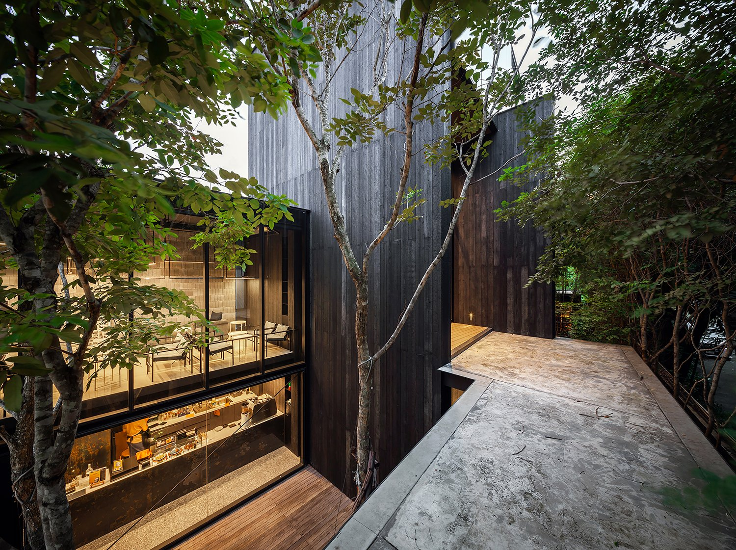 Burnt cedar woods, the feature material of IDIN Architects office. Spaceshift